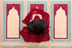 Top aerial view Young beautiful Muslim Woman Praying In Mosque.  Royalty Free Stock Image