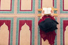 Top aerial view Young beautiful Muslim Woman Praying In Mosque.  Stock Photo