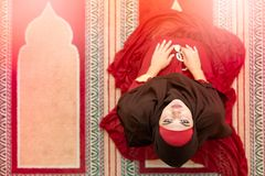 Top aerial view Young beautiful Muslim Woman Praying In Mosque.  Stock Photography