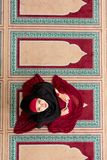 Top aerial view Young beautiful Muslim Woman Praying In Mosque.  Royalty Free Stock Images