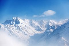Top of alps. In sky Royalty Free Stock Photography