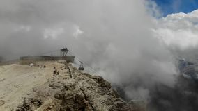 Top of the alps thru clouds. Aerial shot thru fog and clouds stock footage