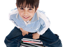 Top angle image of kid sitting on books Stock Photo