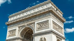 Top of the Arc de Triomphe Triumphal Arch of the Star timelapse is one of the most famous monuments in Paris. Standing at the western end of the Champs stock footage