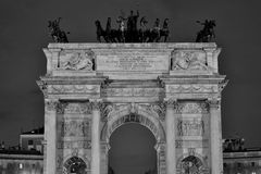 Roof of Arch of Peace. View of the sculpture in the top of Arco della Pace black and white night scene royalty free stock photos
