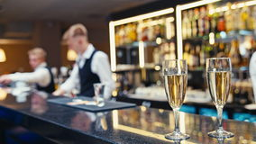 Top of bar in interior and two glasses of champagne stock video footage