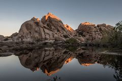 The Top of Barker Dam is Lit Wtih Early Morning Sun. In Joshua Tree wilderness stock photos