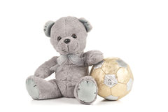 Top Bear with Golden Football. Winning Teddy Bear with gold football on White Background Royalty Free Stock Photos