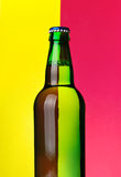 Top of beer bottle. Beer bottle on red and yellow background Stock Images