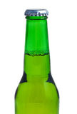 Top of a beer bottle in a white background. Top of a green beer bottle in a white background Royalty Free Stock Photos