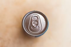 Top of a beer can or soda. Background blurred stock images