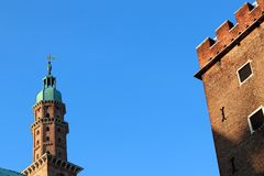 Bell clock tower in Piazza dei Signori with the Basilica Palladiana in Vicenza, Italy royalty free stock photos