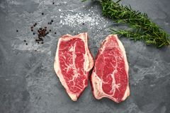 Raw Top-Blade steak dry-aged on stone background