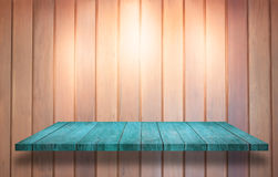 Top of blue wooden shelf with spot light on wooden wall backgrou Stock Photo