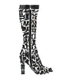 Top boot made of many  shoes Stock Image