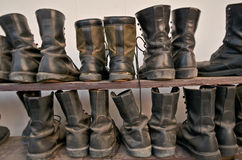 Top boots of soldiers on the racks Stock Images