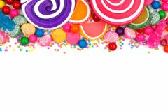 Top border of assorted colorful candies over white Royalty Free Stock Photography