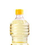 Top bottle of oil, isolated on white Royalty Free Stock Photo
