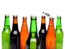 Top bottles of beer and a opener. Royalty Free Stock Image