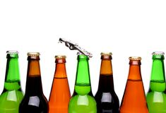 Top bottles of beer and a opener. Stock Photos