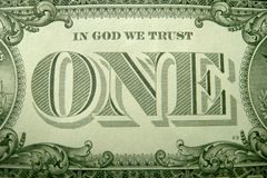 IN GOD WE TRUST and ONE ornately framed by decorative elements from the US dollar. royalty free stock images