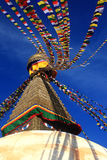 Top of the Boudhanath Stupa with flags in Kathmandu, Nepal. Stock Photo