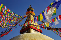 Top of the Boudhanath Stupa with prayer flags Royalty Free Stock Photos