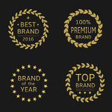 Top brand labels. Golden labels. Best brand, premium brand, brand of the year, top brand. Golden laurel wreath set Royalty Free Stock Photo