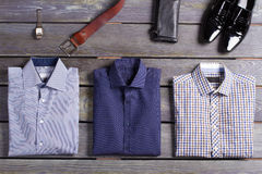 Top branded men's clothing. New shirts and accessories on a beautiful background. Top branded men's clothing Stock Photography