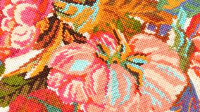 Top of bright embroidery with flowers, close up stock video