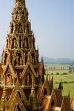Top of Buddha temple with rice field background Royalty Free Stock Photography