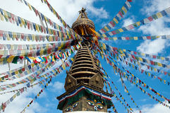 Top of the Buddhist Kathesimbhu Stupa. With buddha eyes and prayer colorful flags, Kathmandu, Nepal Stock Photos