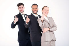 Top businessmen. Three successful and smiling businessmen standi Stock Image
