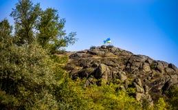 Top of canyon with flag. Ukrainian flag at the top of the Aktovskiy Canyon, Nikolaev region, Ukraine Royalty Free Stock Photography