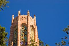Top of carillon tower. A view of the top third of the beautiful Bok Tower, housing carillon bells that play every hour for tourist at the popular botanical Royalty Free Stock Photo