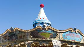 Top of the carousel at Pier 39 San Francisco, California, USA - September 23, 2017. Horizontal shot in motion of ornate hand-painted roof of famous vintage Royalty Free Stock Images