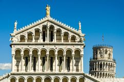 The top of the cathedral and the leaning tower of Pisa Stock Images