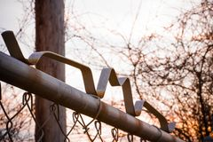 Top of chain link fence at sunset. The top of a chain link fence gate at sunset Royalty Free Stock Photography
