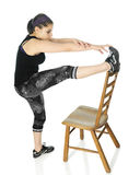 Top-of-the-Chair Toe Touches Stock Images