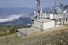 At the top of Chamrousse mountain resort. CHAMROUSSE, FRANCE, July 22, 2017 : At the top of Chamrousse mountain resort, the TV and weather station over the city Stock Photo