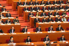 Top Chinese leaders attending parliament meeting. Top Chinese leaders, including President Xi Jinping and Premier Li Keqiang, press the button to approve royalty free stock photo