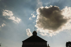 Top of christian church, golden cross on top of orthodox chapel, blue skies and white clouds in background stock photos