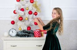 Top christmas decorating ideas for kids room. Kids can brighten up christmas tree by creating their own ornaments. Girl stock photos