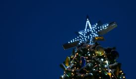 The top of the Christmas tree, against the background of the night sky, festive mood Holidays, New Year stock photos