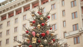 At the top of the Christmas tree, sparkling lights and beautiful Christmas decorations against the backdrop of a large stock video footage