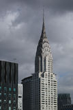 Top of Chrysler building with dark clouds behind it Royalty Free Stock Photography