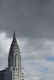 Top of Chrysler building with dark clouds behind it Stock Images