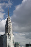 Top of Chrysler building with white and dark clouds behind it Royalty Free Stock Photos