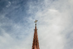 Top of a church. With a blue cloudy sky Royalty Free Stock Photo