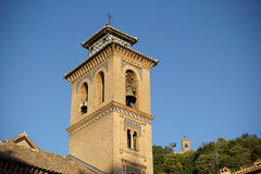 Top of the church in Granada in southern Spain as a typical Spanish bell tower Royalty Free Stock Photo